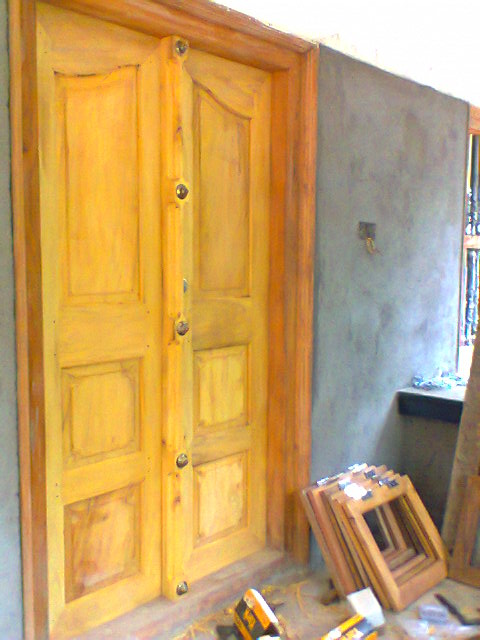 Kerala style traditional double doors wooden joy studio for Traditional main door design