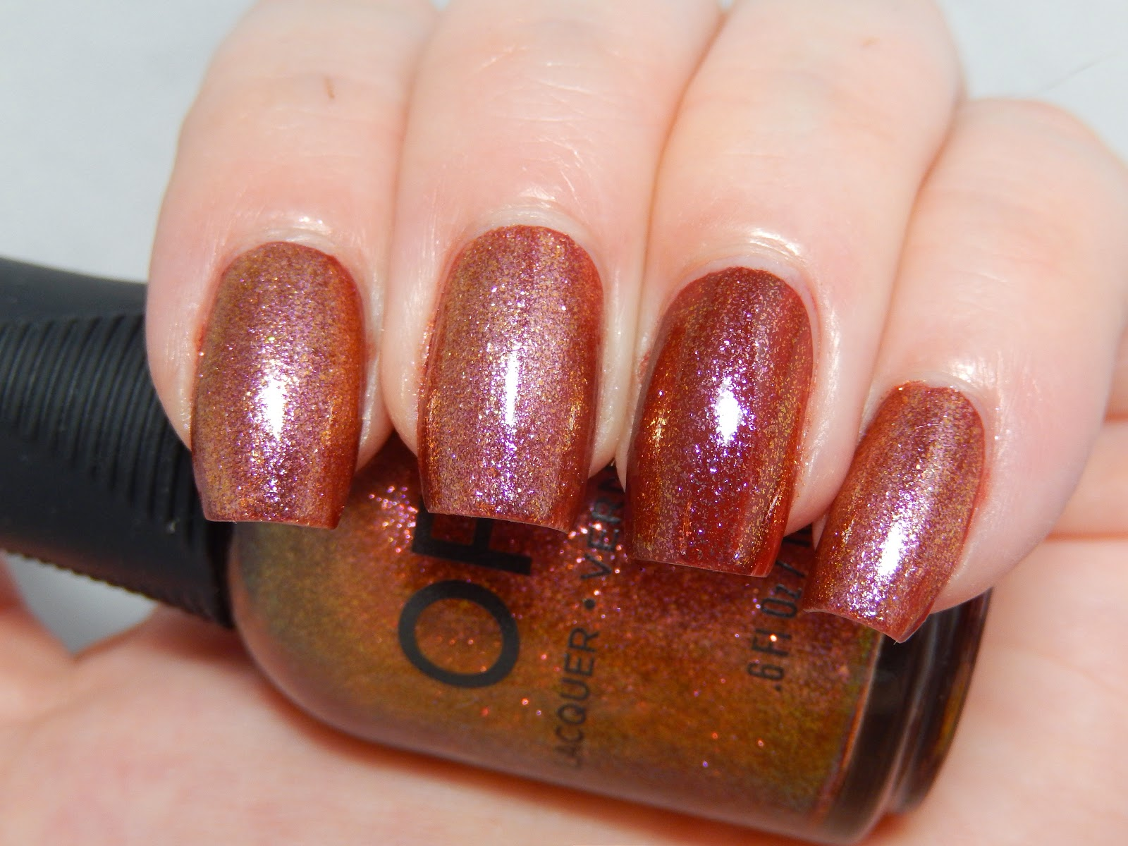 Color Club Lion's Den vs. Orly Brush It On over China Glaze Brownstone