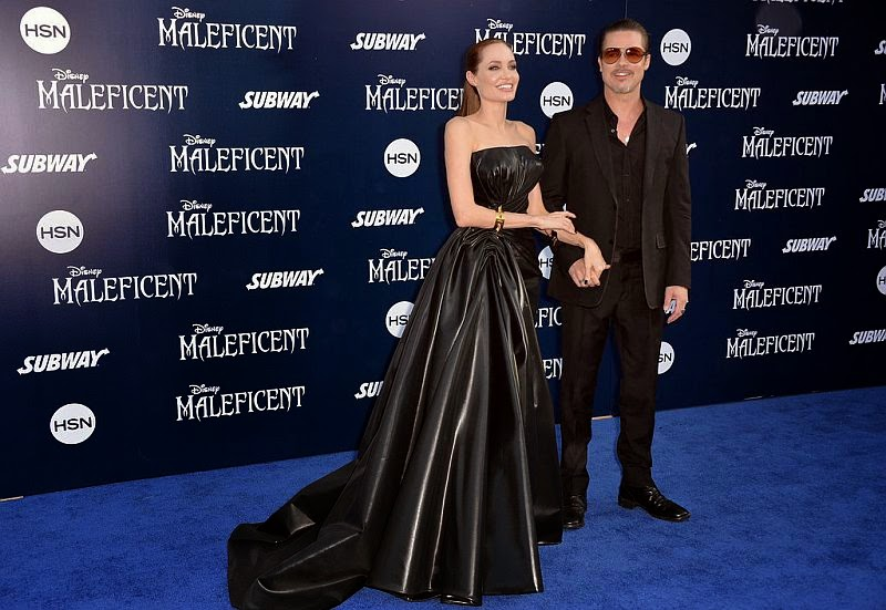 Angelina Jolie was trying to apply her perfect fashion statement when she wore a beautiful black dress alongside her boyfriend Brad Pitt on Wednesday, May 28, 2014 at Los Angeles, USA.