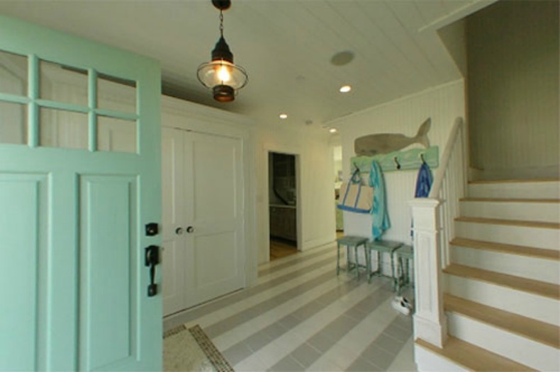 A Pale Aqua Front Door Makes A Beautiful Statement And Has Great Curb  Appeal. Once Inside The Gray And White Painted Stripes On The Wood Floor  Let You Know ...