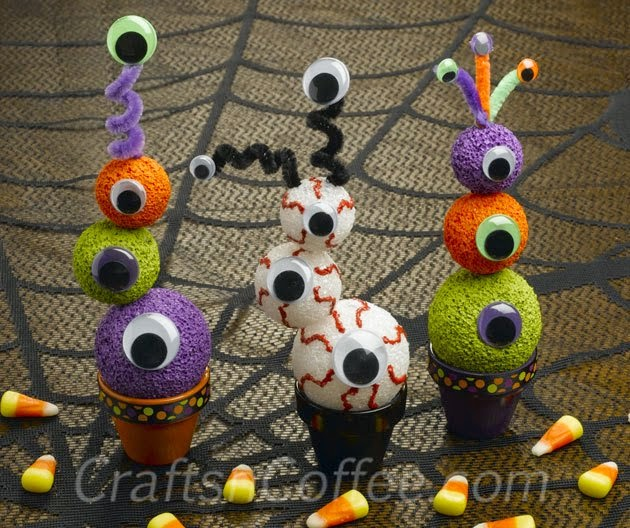 http://craftsncoffee.com/2012/10/04/heres-a-quick-colorful-halloween-craft-halloween-eyeball-topiaries/