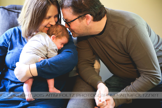 lifestyle photo of newborn and parents