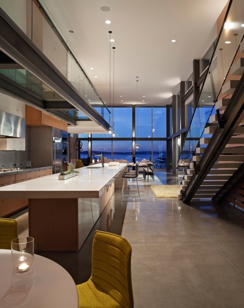Picture of modern kitchen and the sea view in the background