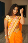 Midhuna New photo session in Saree-thumbnail-4