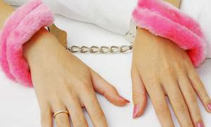 Unlocking Your Sexual Fantasies - handcuffs police pink woman