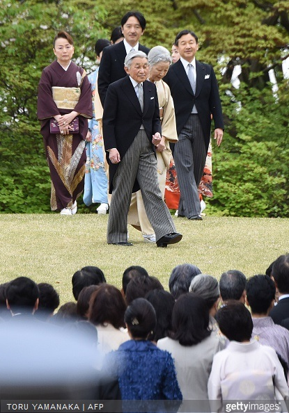 Japanese Emperor Akihito Empress Michiko and members of the imperial family walk towards guests during the annual spring garden party at the Akasaka Palace imperial garden in Tokyo