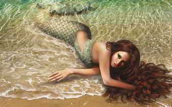 Sirena en la arena
