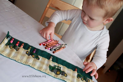 Boy using tractor crayon roll: from STEMmom.org