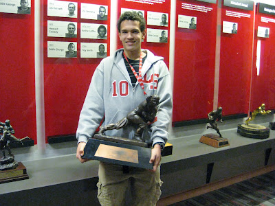 4* WR Derek Kief holding the 72nd Heisman awarded to Ohio State Quarterback Troy Smith in 2006