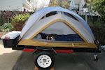 Mini-tent trailer.