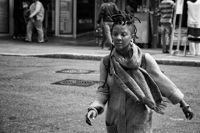 A woman crosses the road in this South African street photograph