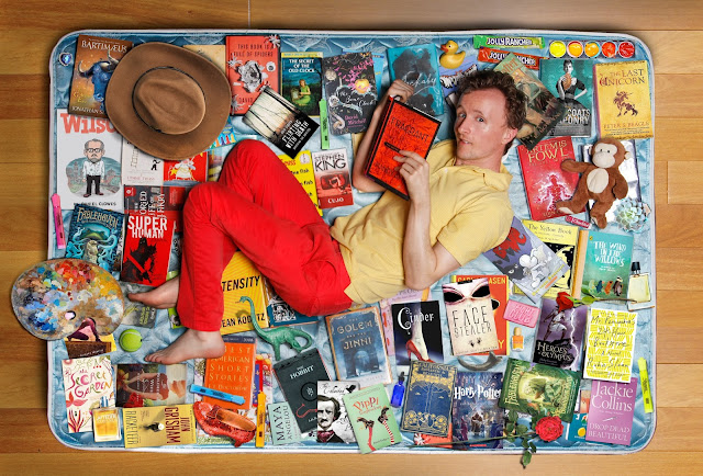 Actor Paul Cram in Bed with Books