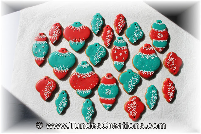 Teal and red gingerbread Christmas decoration by Tunde Dugantsi