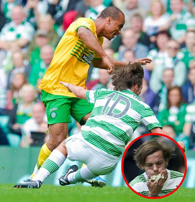 Louis Tomlinson of One Direction, tackled by Aston Villa's Gabriel Agbonlahor