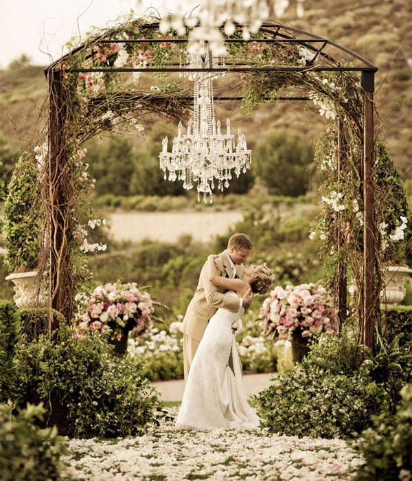 a beautiful romantic and sparkling centerpiece to this wedding gazebo