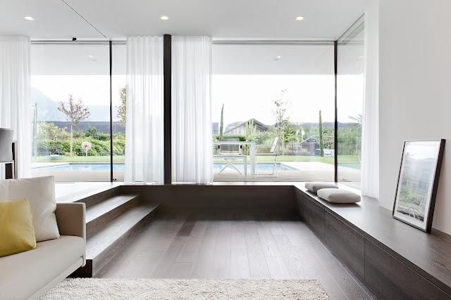 Sunken living room with glass walls