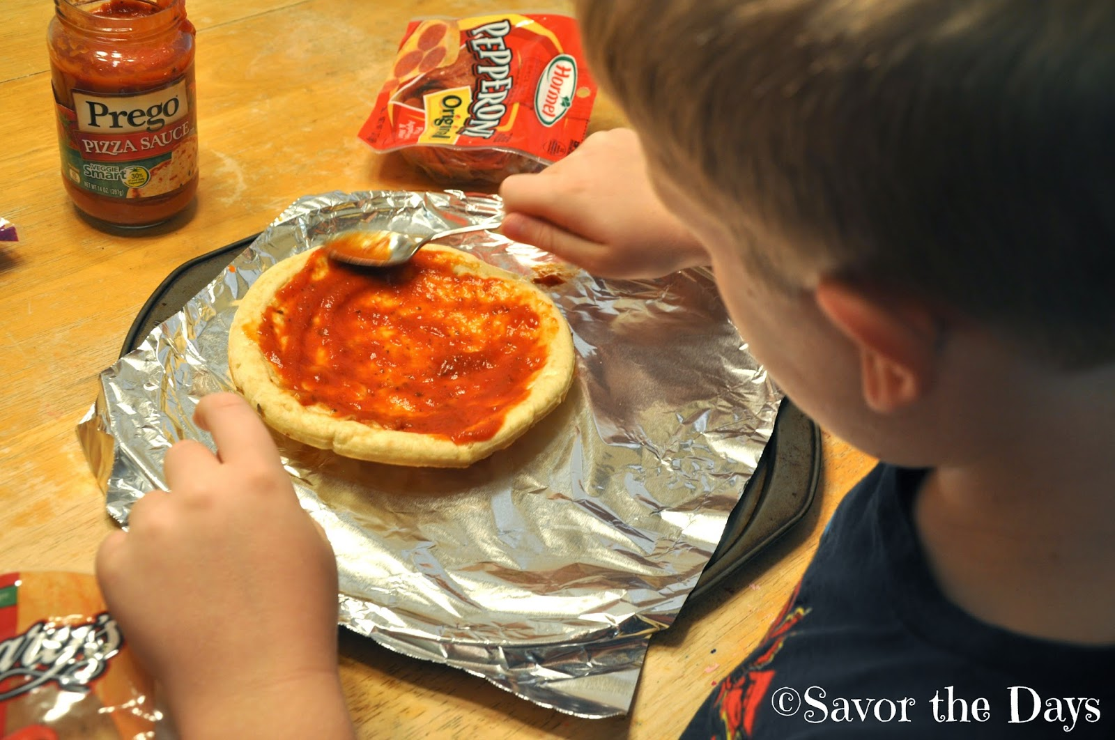 Boy making pizza