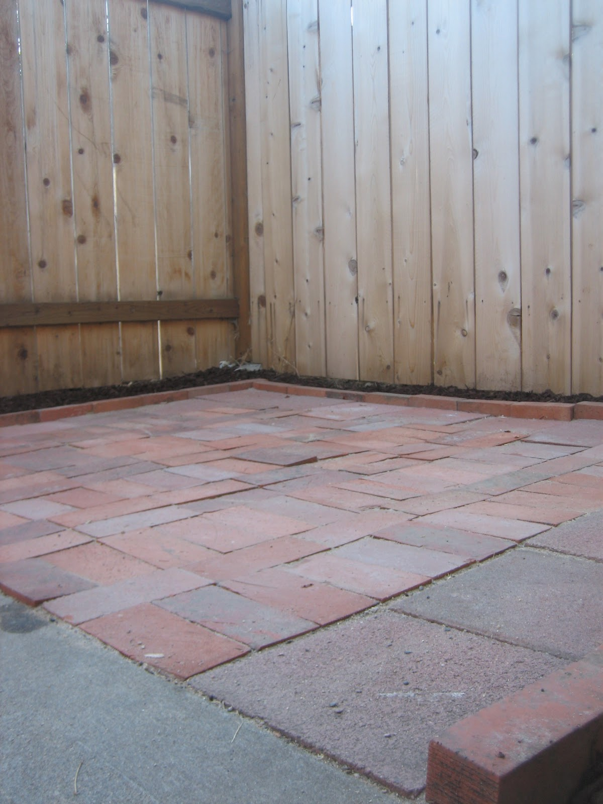 Repurposed, Used Brick Pavers Make For A Cute Patio.