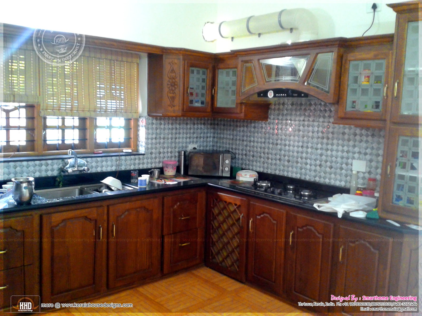 Finished house in kerala in 2000 square feet kerala home for Model kitchen design