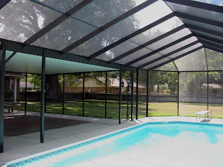 Pool enclosures usa integrated solid and screen roof pool for Lanai structure