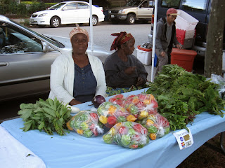 Two immigrant women from Liberia sell their produce in one of West Elmwood's small farmers' markets.