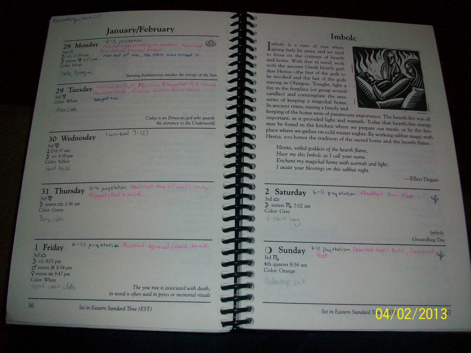 My planner with writing, pink on six of the seven days
