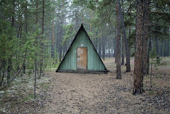 a frame housecabin in the woods