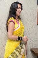Surekha Vani Yellow Saree Hot photos at Yevadu movie Press Meet