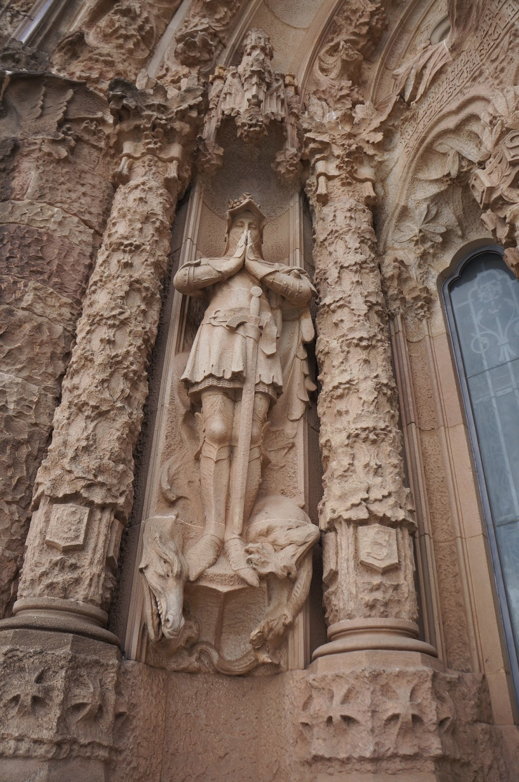 sculptural detail of Saint George in the Sagrada Familia in Barcelona Spain