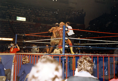 A CBC cameraman looks on as Hulk Hogan sells a beating from challenger Kamala at Maple Leaf Gardens in Toronto, Ontario Canada in December 1986.
