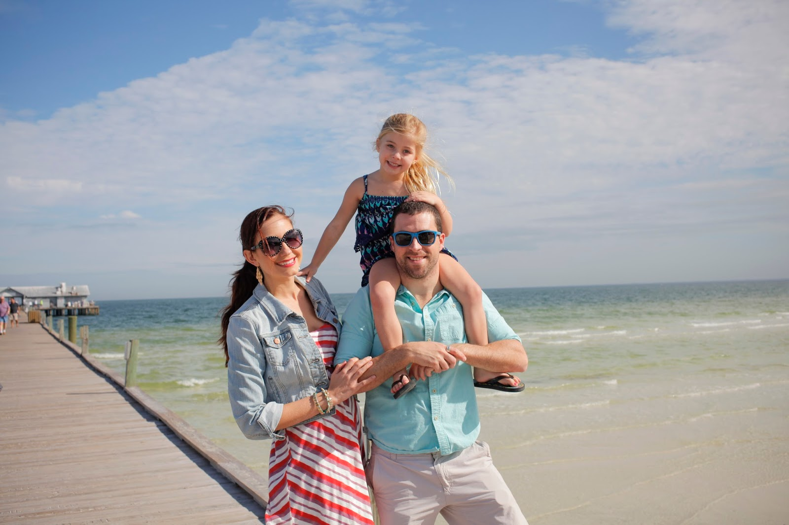 Amy West and family on a fishing pier in Anna Maria Island