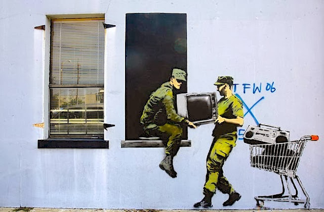 Arts food banksy better out than in images from his new for Banksy mural painted over