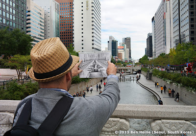 Ben Heine working on a Pencil Vs Camera image  at Cheonggyecheon in Seoul, South Korea © 2013