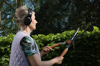 woman gardening headphones listening