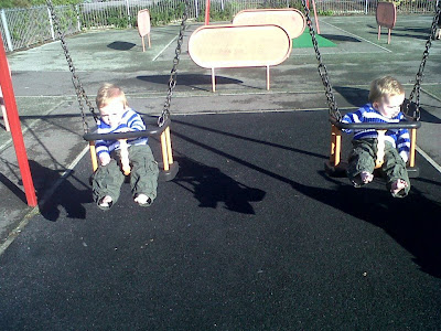 Twin boys in park