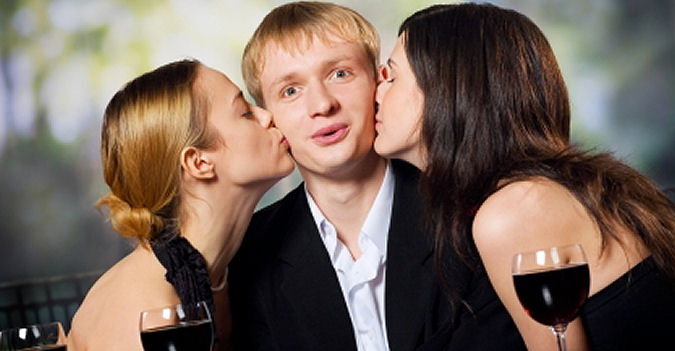 two girls kissing a guy