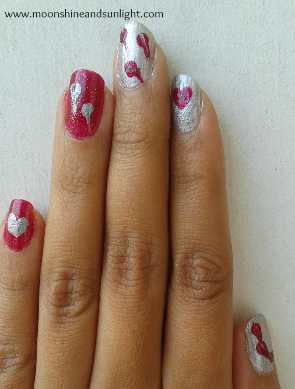 Spolied hearts nail art