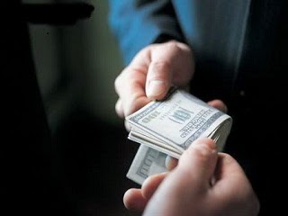 A picture of a bribe offered to an government official.