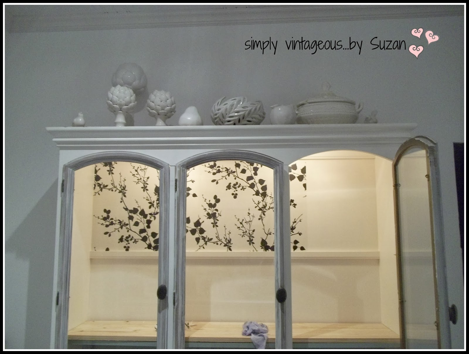Painted, wallpapered hutch