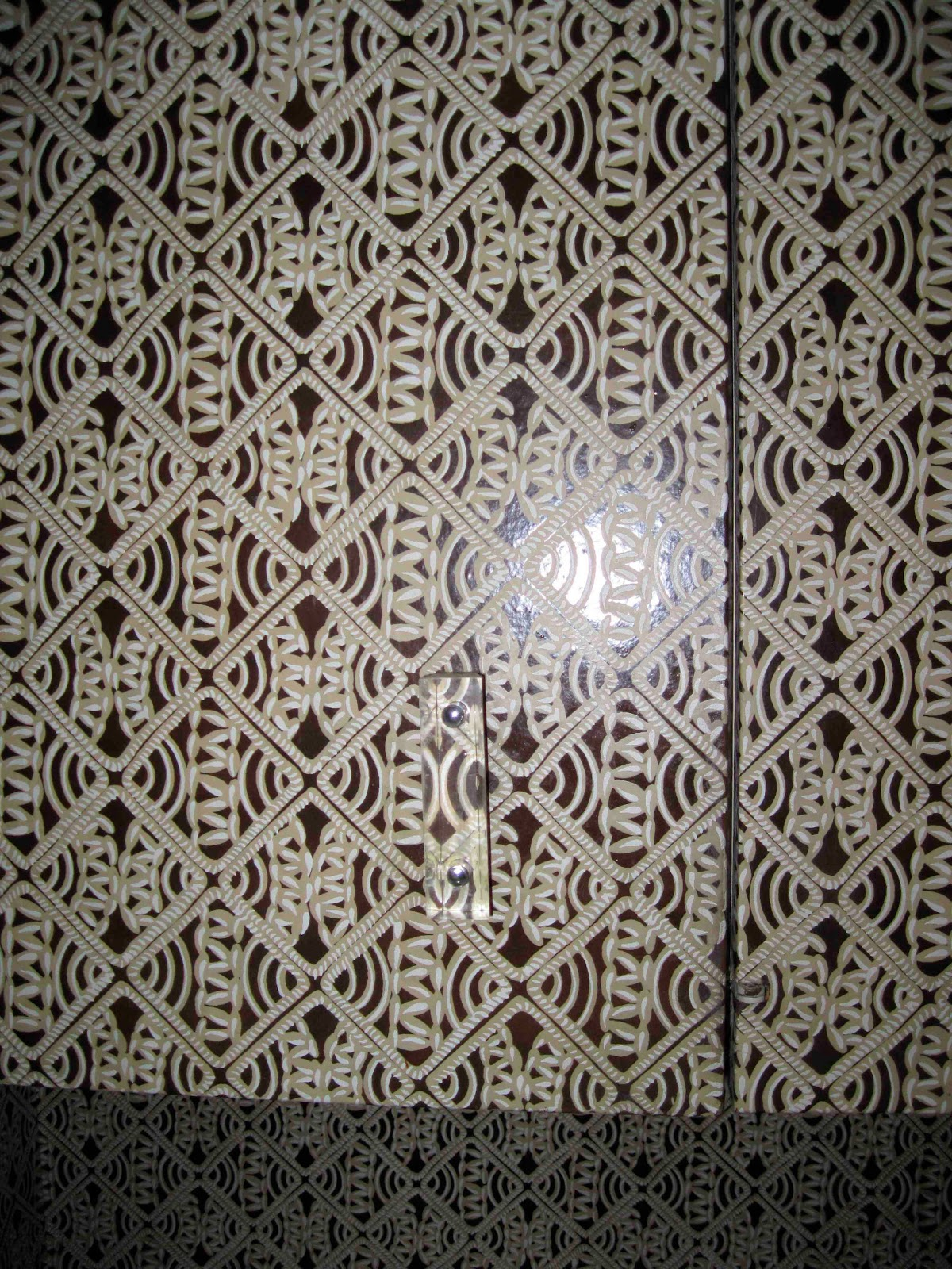 closeup of the wallpaper with lucite handles.