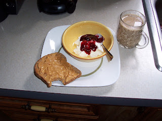 Breakfast> 1 Ezekial toast with peanut butter, 1/2container Fage