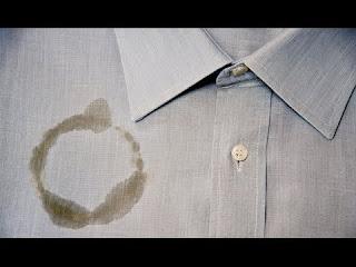 ازالة بقع الزيت عن الملابس دون اثر