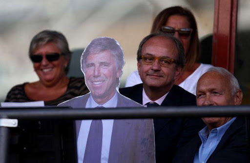 Cardboard cut-out fills seat of banned Genoa president