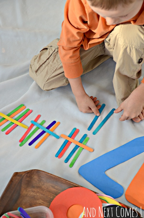 Using craft sticks to make tally marks with this simple math tray from And Next Comes L
