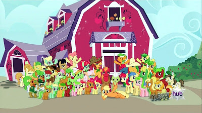 The Apple Family in front of the barn