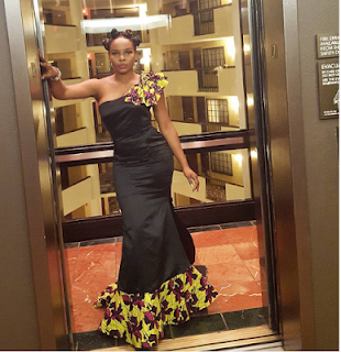 Yemi Alade looks stunning in Zizi Cardow African inspired dress at the AFRIMMA Awards.