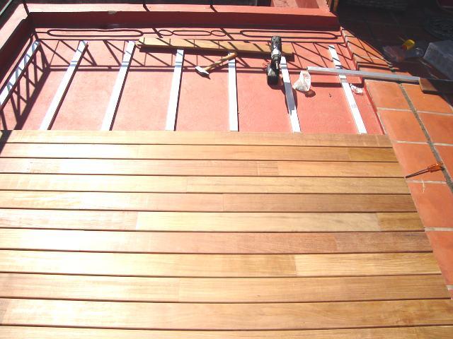 Ara construcciones en general decks en madera una for Suelo de madera terraza