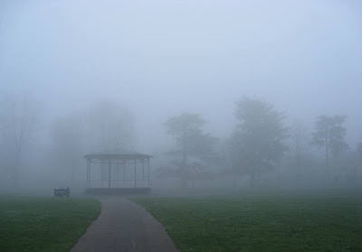 Bandstand and trees in the mist