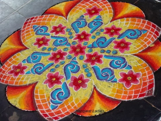 flower and conch rangoli