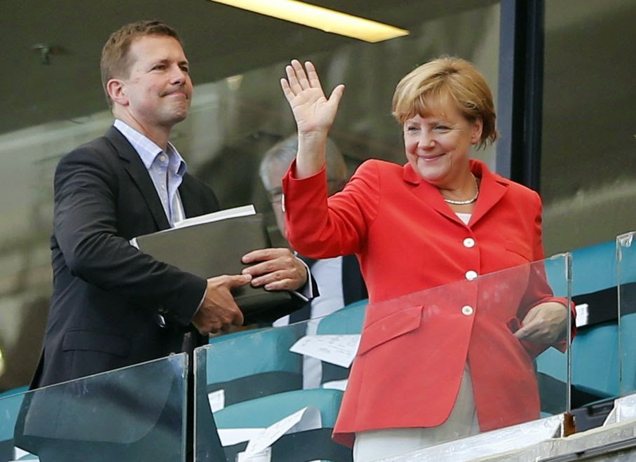 German President Angela Merkel waves after watching the group G World Cup soccer match between Germany and Portugal at the Arena Fonte Nova in Salvador, Brazil, Monday, June 16, 2014. Germany won 4-0.